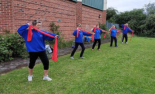 Killamarsh T'ai Chi open air class practicing the Silk Form